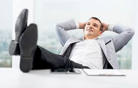 Executive relaxing in office chair